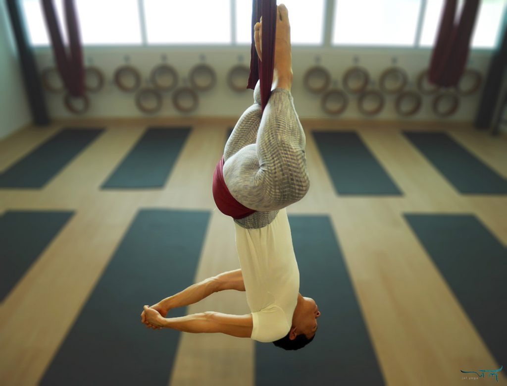 Aerial Yoga Teacher Ming doing an inversion on aerial hammock | jal yoga
