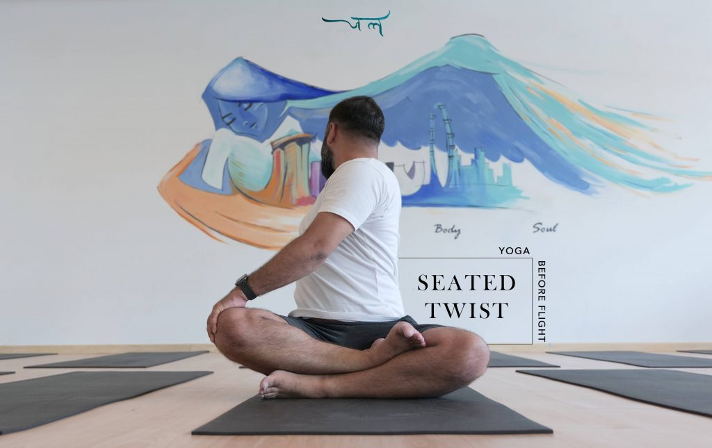 Male Yoga Instructor Practicing Seated Twist Pose Before Flight