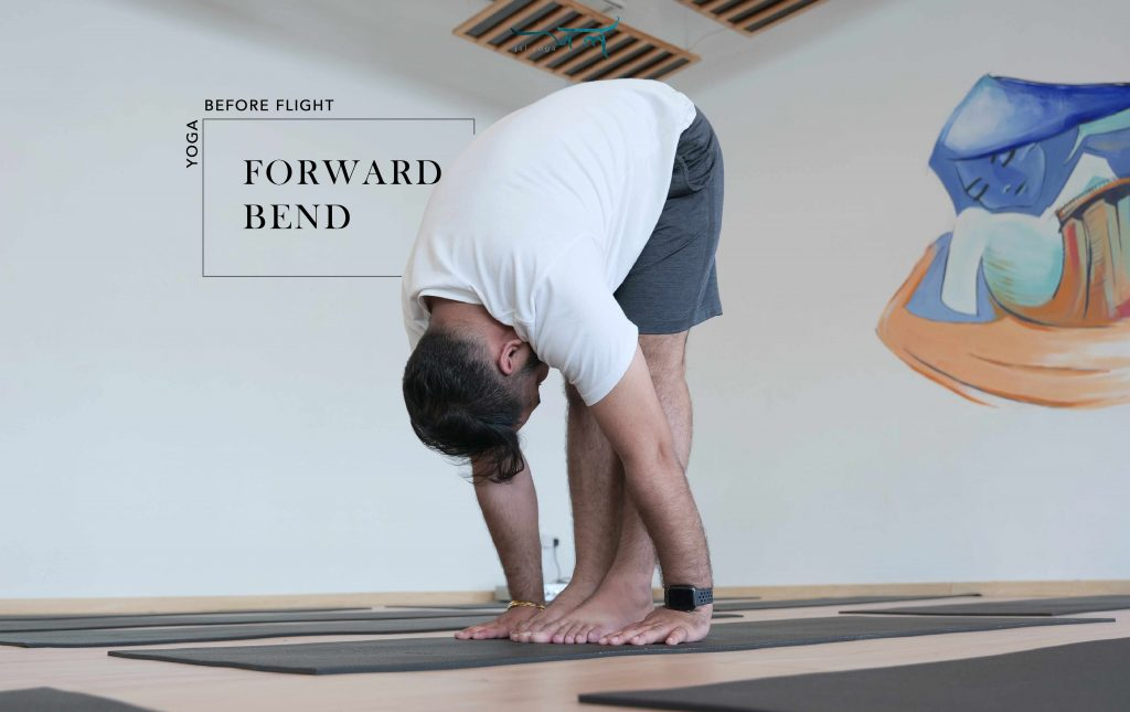 Male Yoga Instructor in his Forward Bend Before Flight