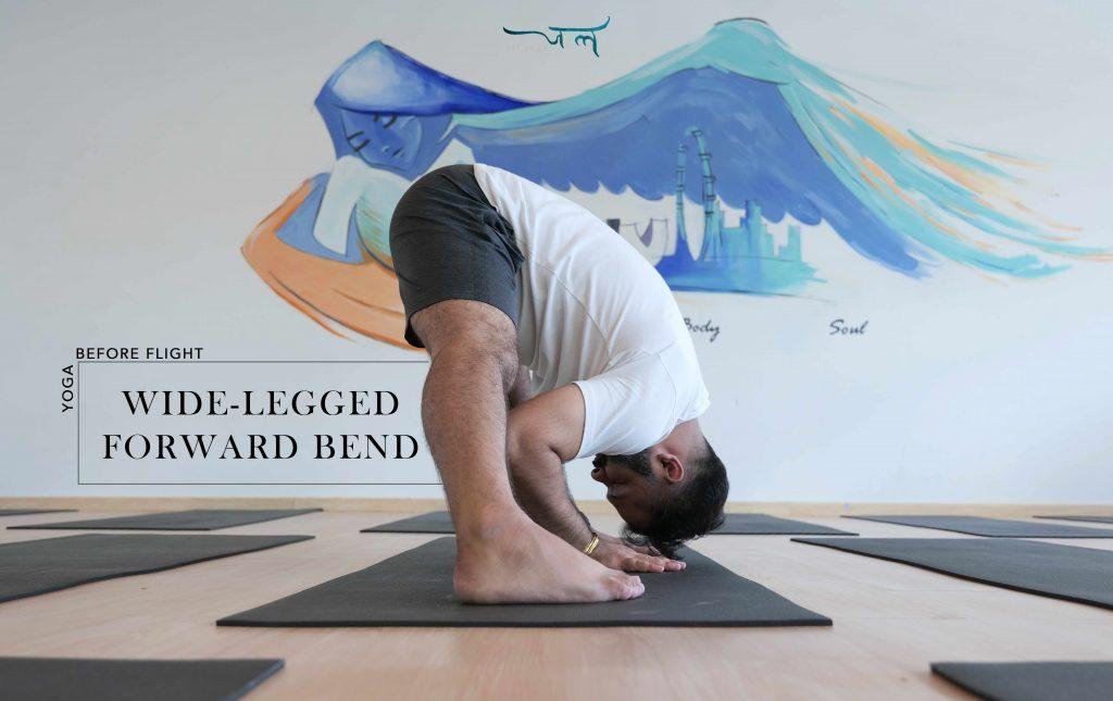 Male Yoga Instructor In Wide-Legged Forward Bend