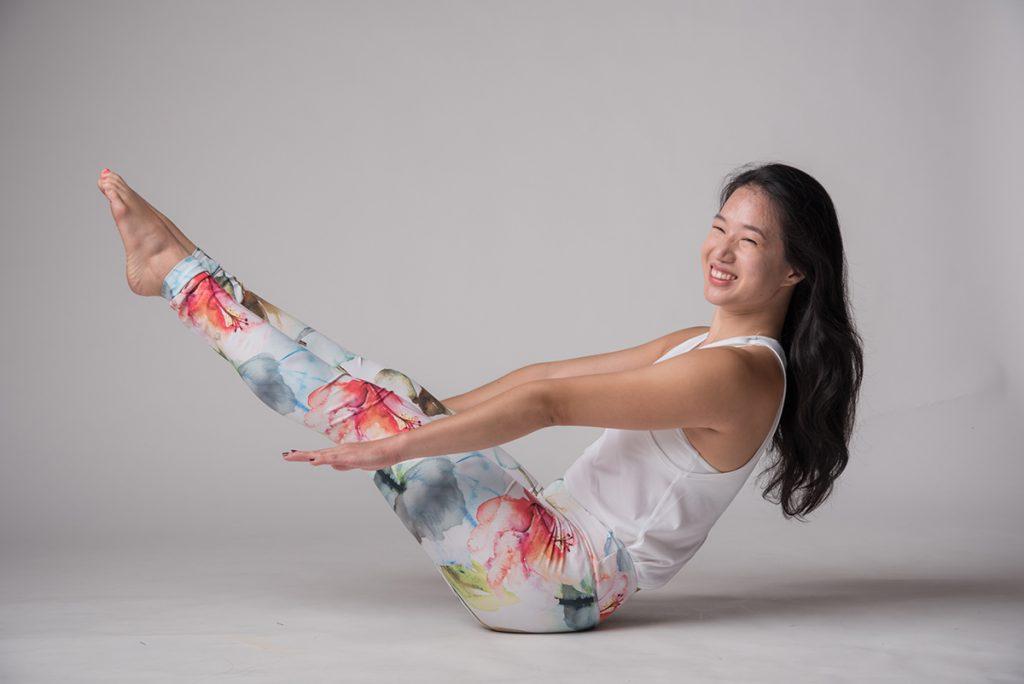Ballet Barre teacher Joanna doing a core strengthening pose | jal yoga