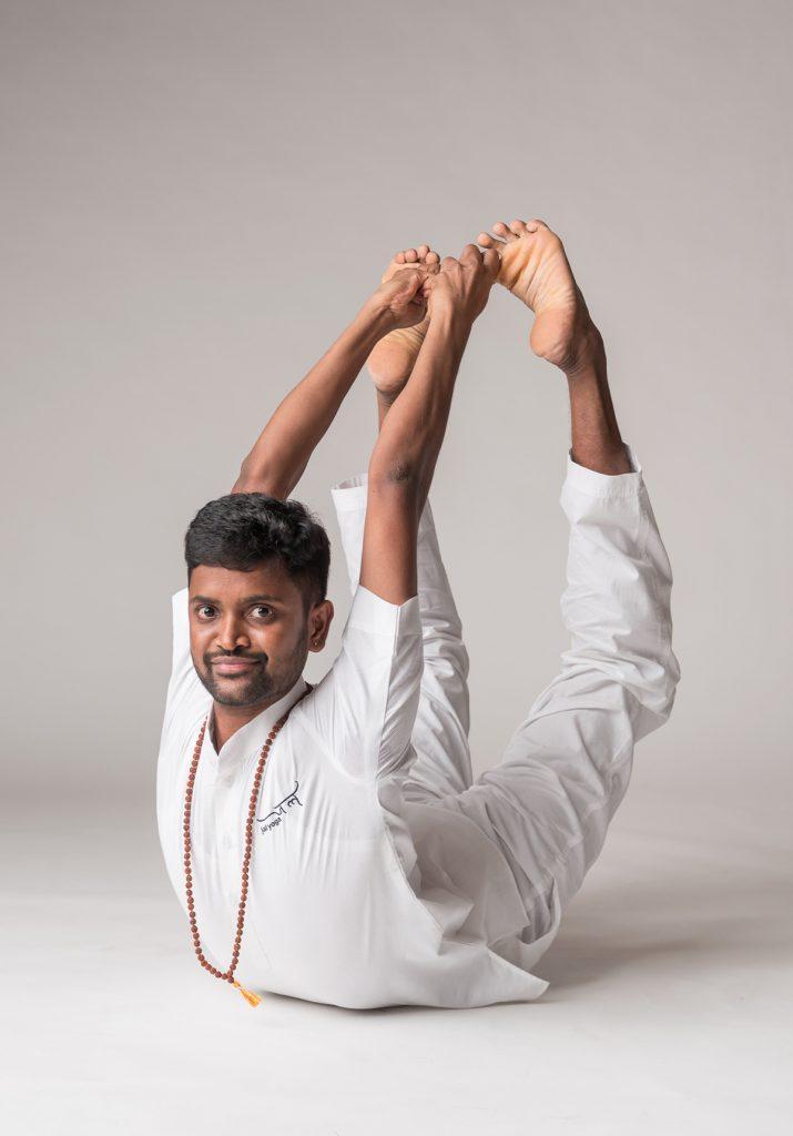 Yoga instructor Krishna doing a boat post | 200 hr hatha yoga teachers training | jal yoga