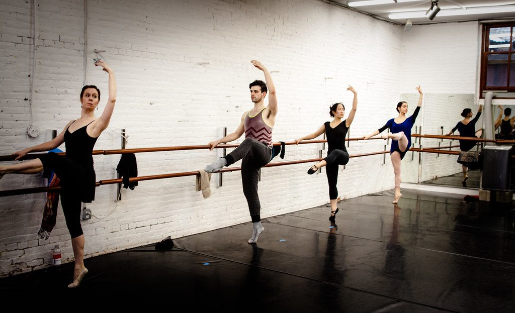 students at a ballet barre class, train like a dancer | jal yoga