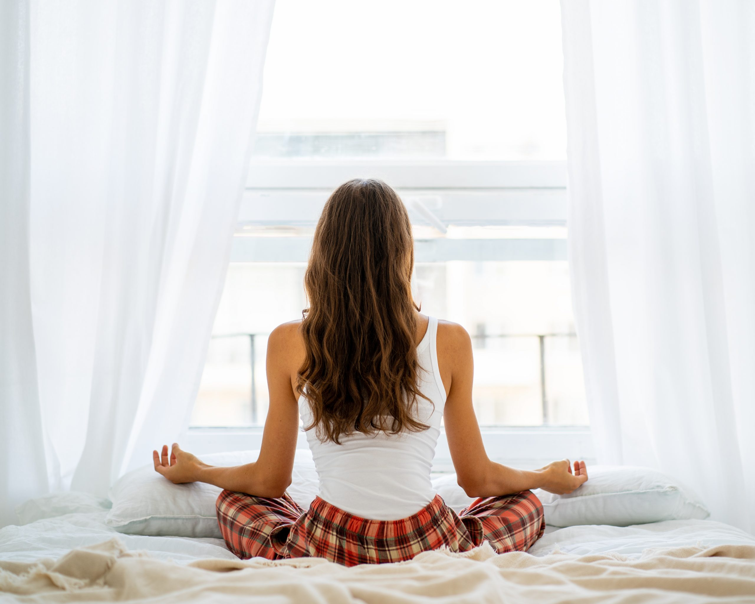 Yoga Poses To Do In Bed To Energise Yourself